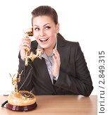 Купить «Девушка в деловом костюме разговаривает по телефону», фото № 2849315, снято 4 мая 2010 г. (c) Gennadiy Poznyakov / Фотобанк Лори