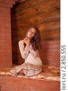 Купить «Девушка греется на печи в старом деревянном доме», фото № 2850555, снято 19 января 2018 г. (c) Армен Богуш / Фотобанк Лори