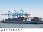 Купить «Большое грузовое судно в промышленном порту», фото № 2882727, снято 16 апреля 2010 г. (c) Losevsky Pavel / Фотобанк Лори