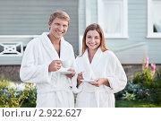 Купить «Мужчина и женщина в белых банных халатах возле коттеджа», фото № 2922627, снято 17 августа 2011 г. (c) Raev Denis / Фотобанк Лори