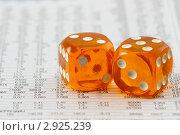 Купить «Оранжевые игральные кубики на листе бумаги со множеством цифр», фото № 2925239, снято 3 октября 2008 г. (c) Дмитрий Наумов / Фотобанк Лори