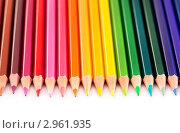 Купить «Крупным планом цветные карандаши на белой бумаге», фото № 2961935, снято 30 октября 2011 г. (c) Николай Винокуров / Фотобанк Лори