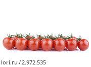 Купить «Ветка помидоров черри в каплях воды на белом фоне», фото № 2972535, снято 13 ноября 2011 г. (c) Сергей Прищепа / Фотобанк Лори
