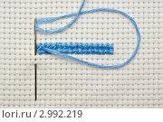 Купить «Вышивка крестом. Иголка с голубой ниткой на канве», фото № 2992219, снято 20 февраля 2011 г. (c) Вячеслав Плясенко / Фотобанк Лори