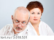 Рассерженные родители. Семейная пара среднего возраста. Стоковое фото, фотограф IEVGEN IVANOV / Фотобанк Лори