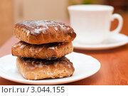 Купить «Тульские пряники на фоне чашки с чаем», эксклюзивное фото № 3044155, снято 29 ноября 2011 г. (c) Игорь Низов / Фотобанк Лори