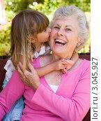 Купить «Маленькая девочка целует бабушку», фото № 3045927, снято 31 января 2006 г. (c) Monkey Business Images / Фотобанк Лори