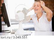 Купить «Женщина за работой в офисе сидит перед вентилятором охлаждения», фото № 3049551, снято 12 января 2007 г. (c) Monkey Business Images / Фотобанк Лори