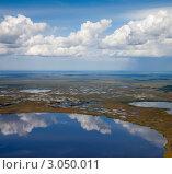 Облака над круглым озером. Стоковое фото, фотограф Владимир Мельников / Фотобанк Лори