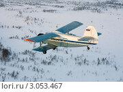 Купить «Ан-2 над тундрой зимой», фото № 3053467, снято 6 января 2009 г. (c) Владимир Мельников / Фотобанк Лори