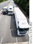 Вид сверху на  грузовики едущими по шоссе, фото № 3075467, снято 2 июля 2006 г. (c) Monkey Business Images / Фотобанк Лори