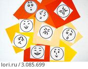 """Изображения разных эмоций на разноцветных квадратах бумаги(злость,удивление,радость,грусть)-""""палитра эмоций"""" Стоковое фото, фотограф Трошина Елена / Фотобанк Лори"""