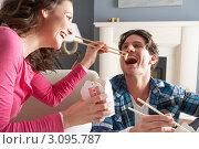 Купить «Девушка кормит парня китайской едой при помощи палочек», фото № 3095787, снято 23 июня 2000 г. (c) Monkey Business Images / Фотобанк Лори
