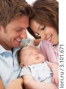 Купить «Портрет счастливых молодых родителей с младенцем, крупным планом», фото № 3101671, снято 19 июля 2010 г. (c) Monkey Business Images / Фотобанк Лори