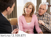 Купить «Пожилая пара дома общается с юристом», фото № 3109871, снято 6 января 2011 г. (c) Monkey Business Images / Фотобанк Лори