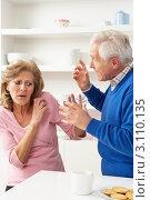 Купить «Испуганную пожилую женщину на кухне ругает муж в синей кофте», фото № 3110135, снято 7 декабря 2010 г. (c) Monkey Business Images / Фотобанк Лори