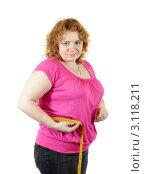 Купить «Полная женщина измеряет сантиметром объемы на белом фоне», фото № 3118211, снято 15 октября 2011 г. (c) Яков Филимонов / Фотобанк Лори