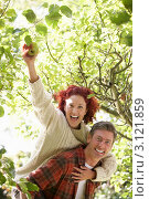 Купить «Веселая пара средних лет собирает яблоки в саду», фото № 3121859, снято 4 октября 2010 г. (c) Monkey Business Images / Фотобанк Лори
