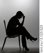 Купить «Силуэт расстроенной женщины на высоких каблуках, сидящей на стуле», фото № 3123523, снято 21 июля 2011 г. (c) Monkey Business Images / Фотобанк Лори