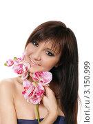 Купить «Красивая девушка с цветком орхидеи», фото № 3150999, снято 6 января 2012 г. (c) ElenArt / Фотобанк Лори