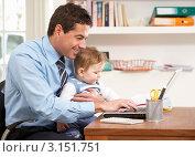 Купить «Надомная работа  - отец сидит перед ноутбуком с маленьким ребенком на коленях», фото № 3151751, снято 8 января 2011 г. (c) Monkey Business Images / Фотобанк Лори