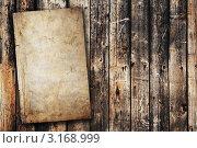 Купить «Лист старой бумаги на деревянной поверхности. Гранж», фото № 3168999, снято 5 февраля 2009 г. (c) vlntn / Фотобанк Лори