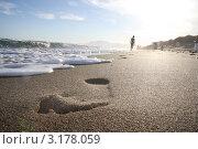 Человеческий след на берегу моря. Стоковое фото, фотограф Дмитрий Романенко / Фотобанк Лори