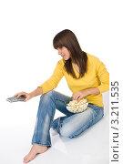 Купить «Девушка переключает каналы пультом от телевизора», фото № 3211535, снято 11 марта 2010 г. (c) CandyBox Images / Фотобанк Лори