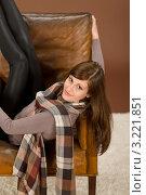 Купить «Счастливая шатенка задрала ноги на спинку кресла», фото № 3221851, снято 6 октября 2010 г. (c) CandyBox Images / Фотобанк Лори