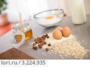Купить «Стол с продуктами для домашней выпечки: мукой, медом, молоком, яйцами и орехами», фото № 3224935, снято 1 апреля 2010 г. (c) CandyBox Images / Фотобанк Лори