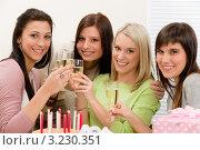 Купить «Четыре девушки на дне рождения поднимают тост», фото № 3230351, снято 29 января 2011 г. (c) CandyBox Images / Фотобанк Лори