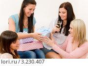 Купить «Девушка вручает подарок имениннице на день рождения», фото № 3230407, снято 29 января 2011 г. (c) CandyBox Images / Фотобанк Лори