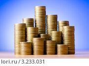Купить «Золотые монеты на синем фоне», фото № 3233031, снято 8 декабря 2011 г. (c) Elnur / Фотобанк Лори