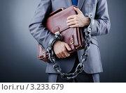Купить «Бизнесмен с портфелем в кандалах», фото № 3233679, снято 12 октября 2011 г. (c) Elnur / Фотобанк Лори