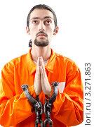 Купить «Мужчина в оранжевой робе с наручниками на руках, сложил руки в мольбе, белый фон», фото № 3271863, снято 12 октября 2011 г. (c) Elnur / Фотобанк Лори
