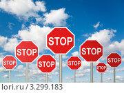 """Купить «Много знаков """"стоп"""" на фоне голубого неба», фото № 3299183, снято 7 октября 2009 г. (c) Losevsky Pavel / Фотобанк Лори"""