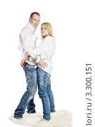 Купить «Девушка и мужчина в джинсах и белых рубашках стоят на шкуре», фото № 3300151, снято 4 апреля 2010 г. (c) Losevsky Pavel / Фотобанк Лори