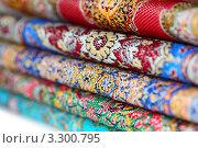 Купить «Стопка разноцветных ковров», фото № 3300795, снято 21 января 2011 г. (c) Losevsky Pavel / Фотобанк Лори