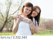 Купить «Две довольные женщины весенним днем на природе», фото № 3332343, снято 4 мая 2011 г. (c) Яков Филимонов / Фотобанк Лори
