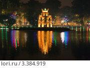 Купить «Новогодняя подсветка башни Черепахи (Таб Руа) на озере Хоан Кием. Ночной Ханой. Вьетнам», фото № 3384919, снято 4 февраля 2011 г. (c) Ольга Липунова / Фотобанк Лори