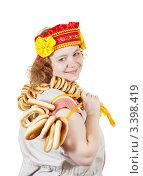 Купить «Полная девушка с баранками», фото № 3398419, снято 15 октября 2011 г. (c) Яков Филимонов / Фотобанк Лори