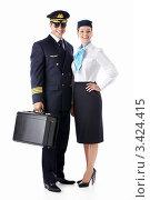 Купить «Пилот и стюардесса стоят на белом фоне», фото № 3424415, снято 22 сентября 2011 г. (c) Raev Denis / Фотобанк Лори