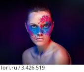 Купить «Девушка с ярким боди-артом на лице», фото № 3426519, снято 3 января 2012 г. (c) Павел Кужелев / Фотобанк Лори