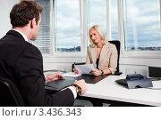 Купить «Девушка интервьюирует мужчину при приеме на работу», фото № 3436343, снято 13 ноября 2010 г. (c) Андрей Попов / Фотобанк Лори