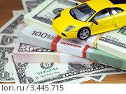 Купить «Игрушечный автомобиль на пачках долларов и евро», фото № 3445715, снято 8 ноября 2011 г. (c) ElenArt / Фотобанк Лори