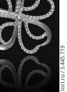 Купить «Ювелирное украшение с бриллиантами на черном фоне», фото № 3445719, снято 8 ноября 2011 г. (c) ElenArt / Фотобанк Лори