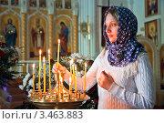Купить «Девушка ставит свечку в православном храме», фото № 3463883, снято 13 апреля 2012 г. (c) Андрей Ярославцев / Фотобанк Лори