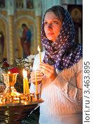 Купить «Девушка ставит свечку в православном храме», фото № 3463895, снято 16 августа 2018 г. (c) Андрей Ярославцев / Фотобанк Лори