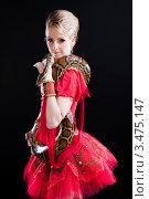 Балерина в красной пачке с сетчатым питоном на темном фоне. Стоковое фото, фотограф Irina Danilova / Фотобанк Лори