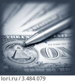 Купить «Американские доллары и ручка», фото № 3484079, снято 4 марта 2011 г. (c) ElenArt / Фотобанк Лори